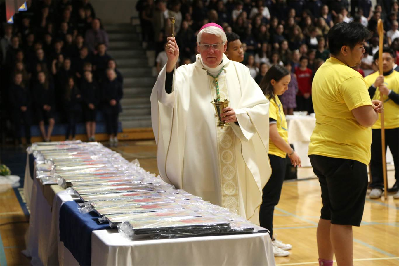 Bishop Crosby blesses the Catholic Education Week plaques prior to their distribution to schools. The plaque was designed by Angela Guglielmo, a Grade 8 student at St. Mark Catholic Elementary School. Photo by Jenna Madalena.